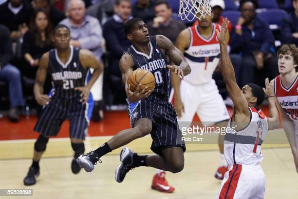 DeQuan Jones of the Orlando Magic puts up a shot in front of Garrett Temple of the Washington Wizards during the first half at Verizon Center on...