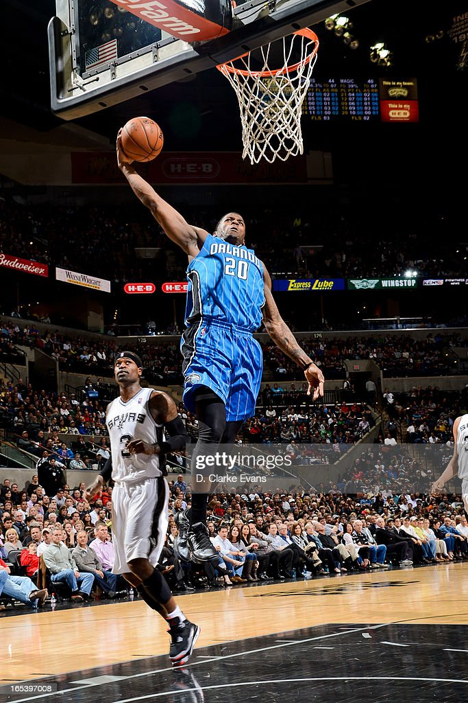 DeQuan Jones #20 of the Orlando Magic rises for a dunk against the San Antonio Spurs on April 3, 2013 at the AT&T Center in San Antonio, Texas.