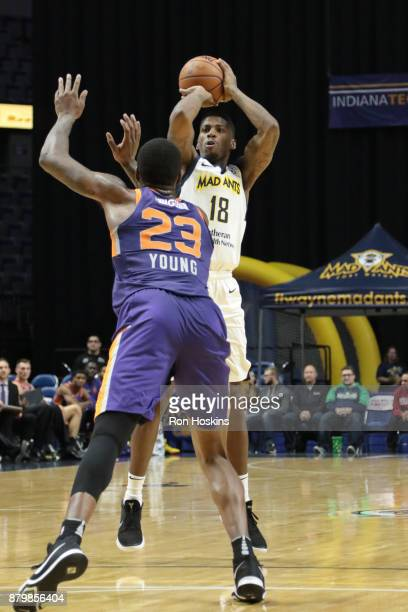 DeQuan Moore of the Fort Wayne Mad Ants shoots over Mike Young of the Northern Arizona Suns during their NBDL game at Memorial Coliseum on November...