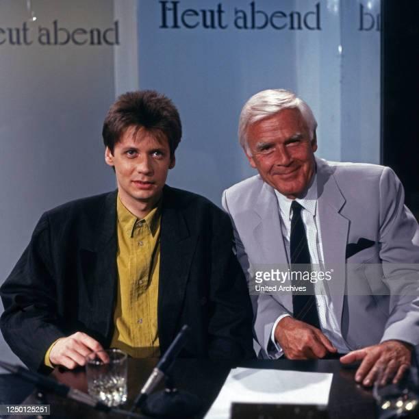"""Der deutsche Journalist und Fersnehmoderator Günther Jauch zu Gast bei Joachim Fuchsberger in der Talkshow """"Heut' abend"""", Deutschland 1990er Jahre."""