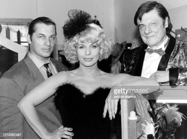 Der deutsche Schauspieler, Regisseur und Autor Herbert Bötticher posiert mit seinen Kollegen Heinz Hoenig und Senta Berger am 28.6.1991 am Rande von...