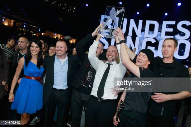 Der Graf of the band Unheilig from North Rhine-Westphalia poses with contest hosts Stefan Raab , Johanna Klum and band members after winning first...