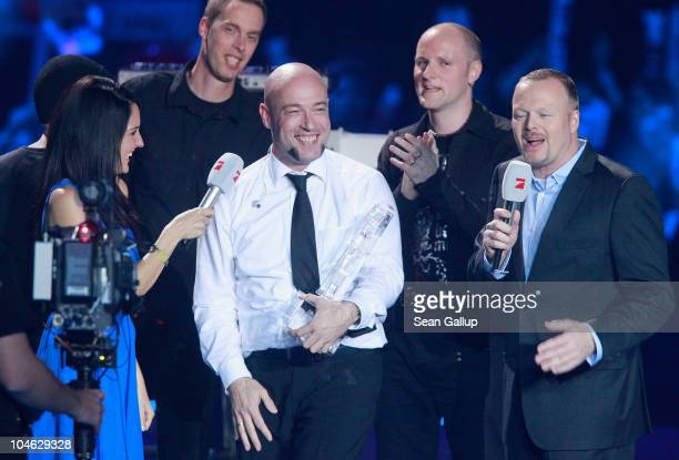 Der Graf of the band Unheilig from North Rhine-Westphaliareceives his award from contest hosts Stefan Raab and Johanna Klum after winning first place...