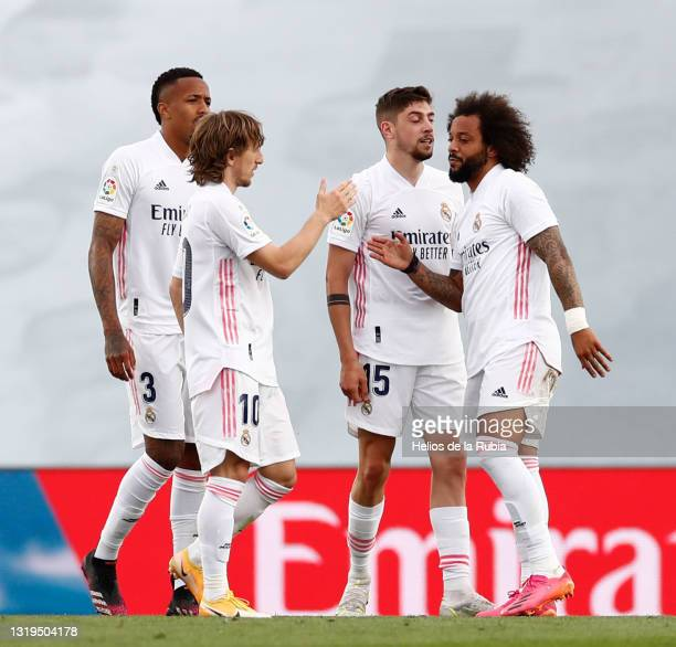 Éder Militão and Luka Modric both of Real Madrid with teammates Federico Valverde and Marcelo Silva in action during the La Liga Santander match...