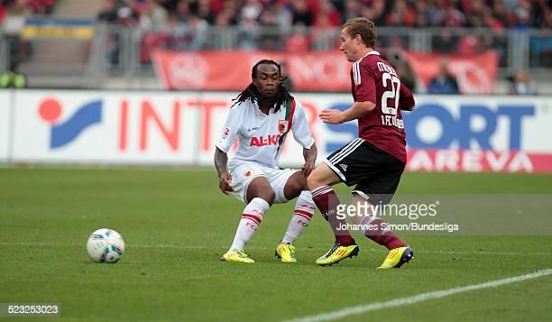 Der Nuernberger Markus Mendler und der Augsburger Daniel Baier kaempfen waehrend dem Bundesligaspiel zwischen dem 1 FC Nuernberg und dem FC Augsburg...