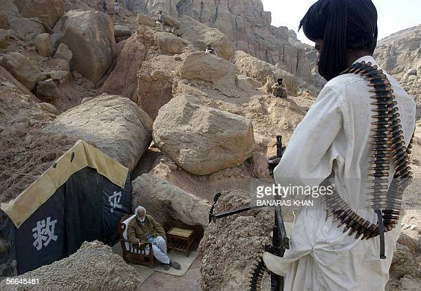 Pakistani armed tribesmen guard their leader Nawab Akbar Bugti in a cave at the remote mountainous area of Dera Bugti 22 January 2006 Bugti a...
