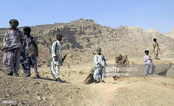 Pakistani tribal guards stand alert to provide security to their leader Nawab Akbar Bugti in the remote mountainous area of Dera Bugti 22 January...