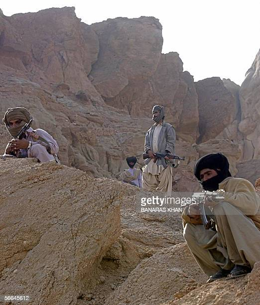 Pakistani tribal guards stand alert to provide security to their leader Nawab Akbar Bugti at the remote mountainous area of Dera Bugti 22 January...