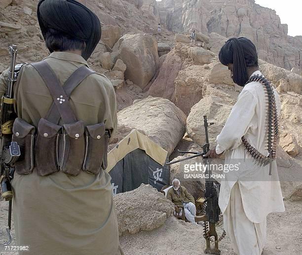 This picture taken 24 January 2006 shows Pakistani rebel tribesmen guarding Bugti tribal leader Nawab Akbar Bugti in the remote mountainous area of...
