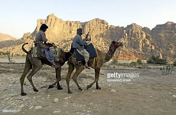 Tribal guards patrol on camels to provide security to their leader Nawab Akbar Bugti at the remote mountainous area of Dera Bugti 22 January 2006...