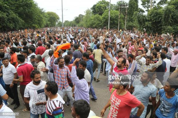 Dera followers gather to protest after the Dera chief verdict at CBI court on August 25 2017 in Panchkula India Gurmeet Ram Rahim the selfstyled...