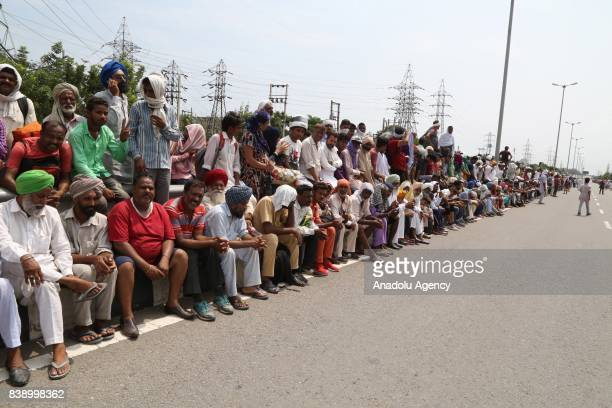 Dera followers gather to protest after the Dera chief verdict at CBI court on August 25, 2017 in Panchkula, India. Gurmeet Ram Rahim, the self-styled...
