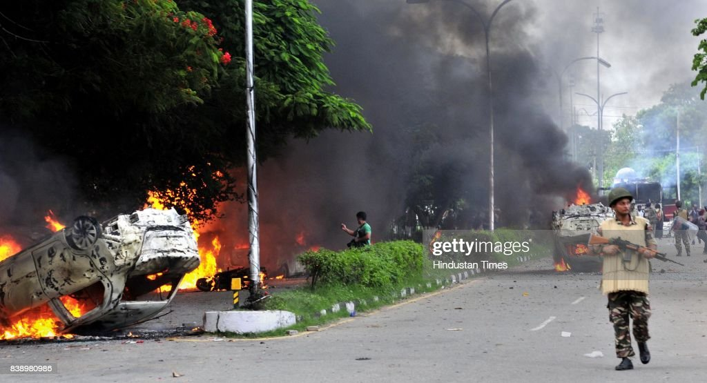 Dera followers set vehicles on fire in Panchkula sector 4 after the dera chief verdict at CBI courton August 25 2017 in Panchkula India Gurmeet Ram...