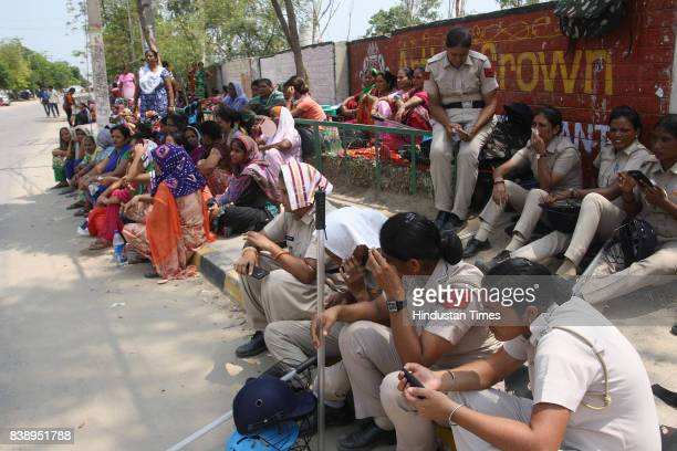 Dera Sacha Sauda followers men and women in large number gathered near the HUDA chowk on Thursday on August 24 2017 in Sirsa India The godman was...