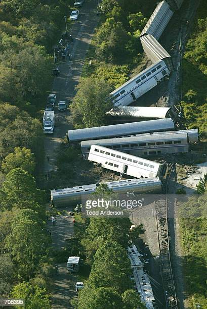 A derailed Amtrack train is shown April 19 2002 near Crescent City FL The Amtrak auto train was carrying approximately 440 passengers northbound as...