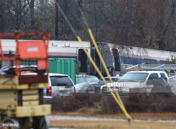 A derailed Amtrak car can be seen up the tracks near a crossing after an early morning collision with a CSX freight train on February 4 2018 in Cayce...