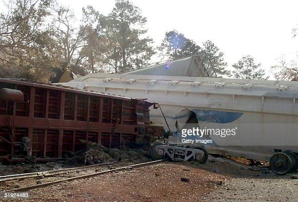 Derailed cars lie at the scene of a train collision January 6 2004 in Graniteville South Carolina in this photo released by the US Environmental...