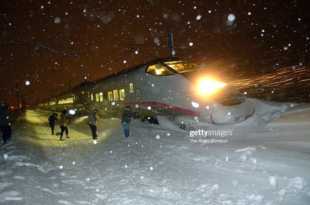 Derailed Komachi 25, Akita Shinkansen bullet train is seen in the snow on March 2, 2013 in Omagari, Akita, Japan. Passengers were stuck for six hours in the coaches. Eight people died in the accidents related to the heavy snow over the weekend.