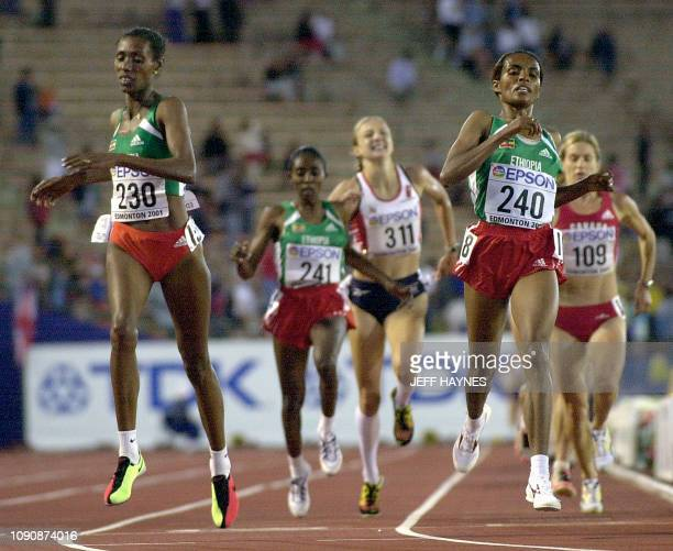 Derartu Tulu and Berhane Adere of Ethiopia finish the 10000M final along with Gete Wami of Ethiopia and Paula Radcliffe of Great Britain at the 8th...