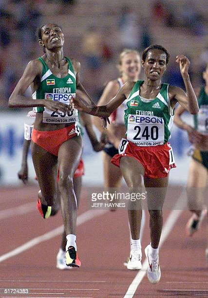 Derartu Tulu and Berhane Adere of Ethiopia finish the 10000M final the 8th World Championships in Athletics 07 August 2001 in Commonwealth Stadium in...
