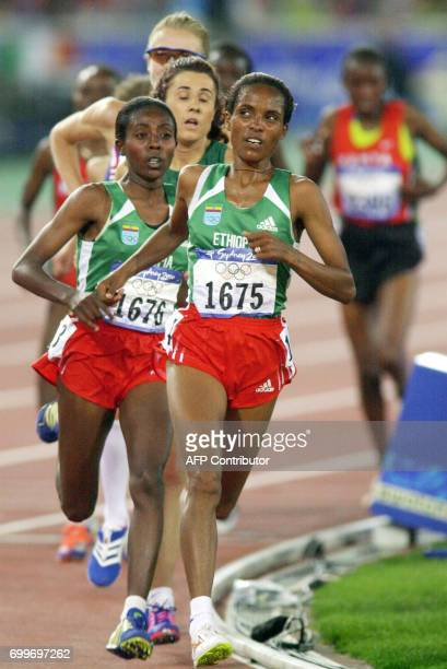 Derartu Tulu of Ethiopia and compatriot Gete Wami power over the track followed by Fernande Ribeiro of Portugal in the women's 10000m final 30...