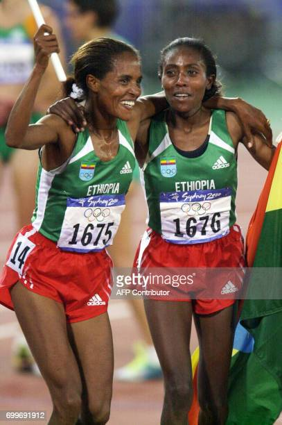 Derartu Tulu of Ethiopia and compatriot Gete Wami react after respectively placing first and second in the women's 10000m final 30 September 2000 at...