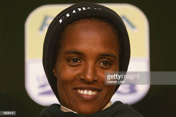 Derartu Tulu of Ethiopia answers questions at a press conference prior to the 2003 Flora London Marathon on April 9 2003 in London