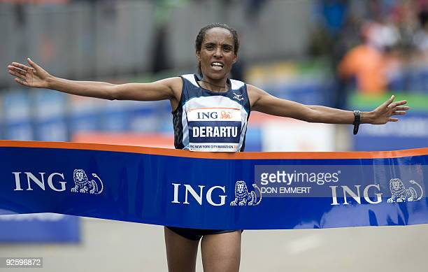 Derartu Tulu of Ethiopia crosses the finish line of the New York City Marathon November 1 2009 in New York Tulu pulled away in the final mile to beat...