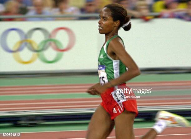 Derartu Tulu of Ethiopia powers over the track to place first in the women's 10000m final 30 September 2000 at the Sydney Olympic Games Tulu won the...