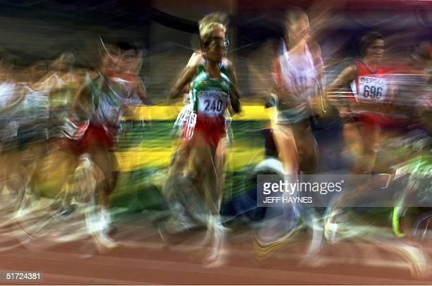 Derartu Tulu of Ethiopia running the 10000M final at the 8th World Championships in Athletics 07 August 2001 in Commonwealth Stadium in Edmonton...
