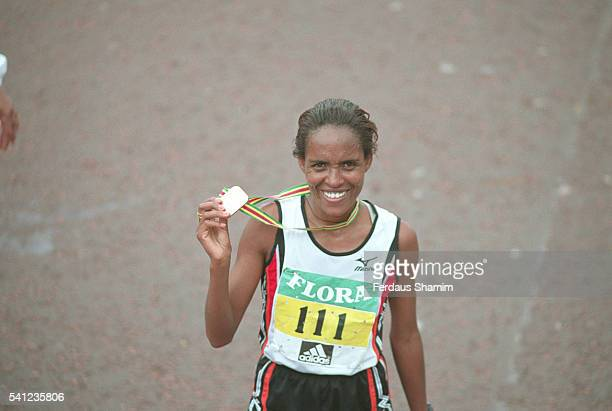 Derartu Tulu of Ethiopia was the first woman to finish in the 26mile marathon with a time of 2 hours and 24 minutes