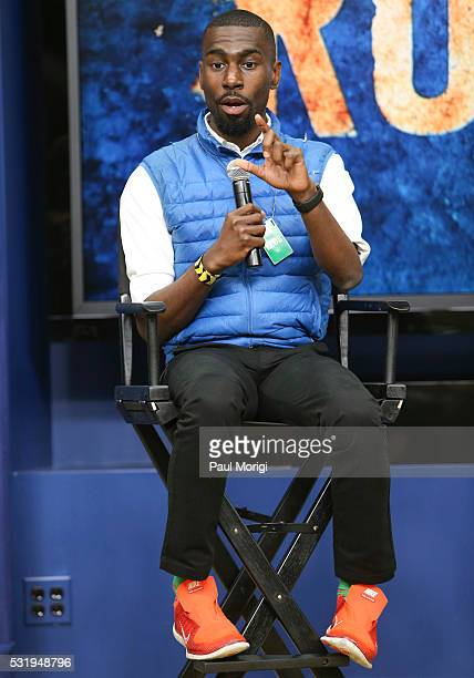 DeRay McKesson speak on a panel moderated by Joshua DuBois during the 'HISTORY Brings 'Roots' Cast And Crew To The White House For Screening' at the...