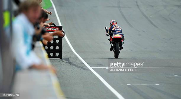 Derbi rider Marc Marquez of Spain celebrates winning the 125 cc moto race of the Moto Grand Prix of Germany at the Sachsenring Circuit on July 18...