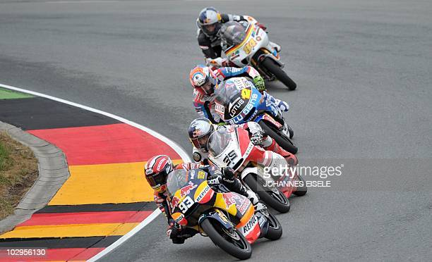 Derbi rider Marc Marquez of Spain leads the pack of the 125 cc moto race of the Moto Grand Prix of Germany at the Sachsenring Circuit on July 18 2010...