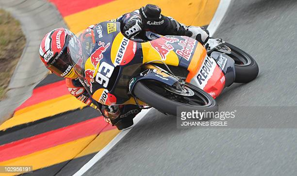Derbi rider Marc Marquez of Spain races to victory of the 125 cc moto race of the Moto Grand Prix of Germany at the Sachsenring Circuit on July 18...