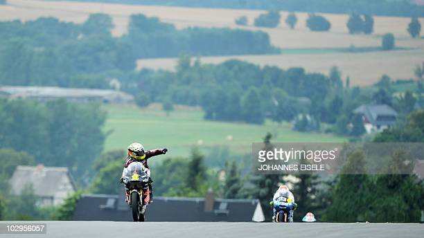 Derbi rider Sandro Cortese of Germany celebrates his third place of the 125 cc moto race of the Moto Grand Prix of Germany at the Sachsenring Circuit...