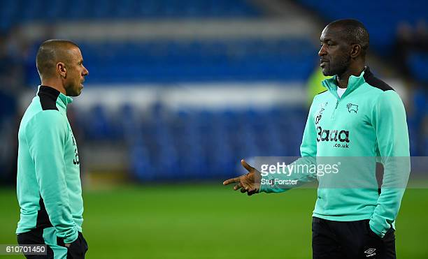 Derby coaches Kevin Phillips and Chris Powell look on before the Sky Bet Championship match between Cardiff City and Derby County at Cardiff City...