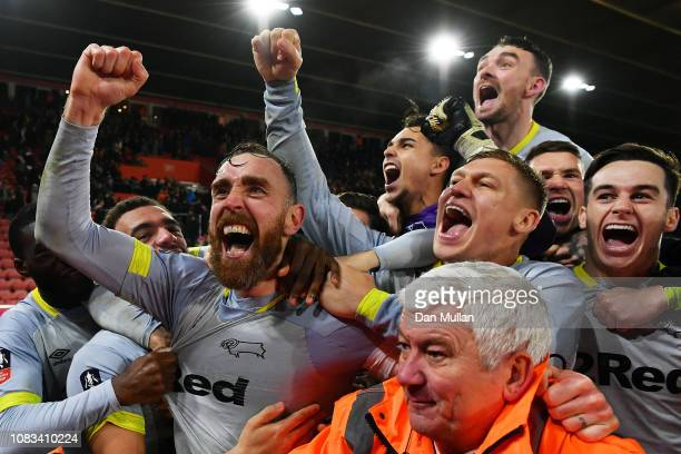 Derby County Captain Richard Keogh celebrates with his team after winning the penalty shoot out during the FA Cup Third Round Replay match between...