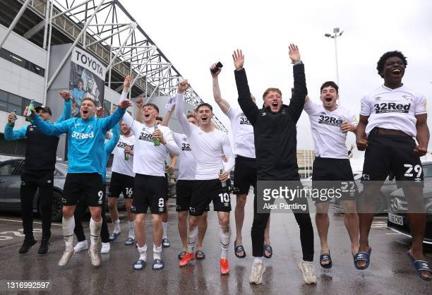 Derby County celebrate with fans outside the stadium as they secure safety in the Championship the Sky Bet Championship match between Derby County...