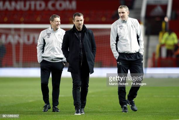 Derby County coach Kevin Poole and first team coach Mark Sale with manager Gary Rowett prior to the FA Cup third round match at Old Trafford...