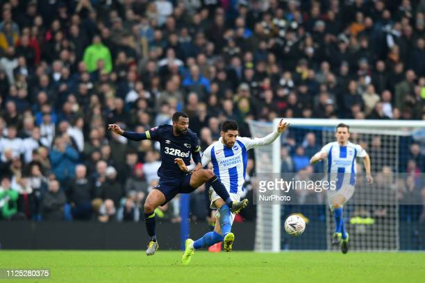 Derby County defender Ashley Cole battles with Brighton forward Alireza Jahanbakhsh during the Emirates FA Cup 5th round tie between Brighton and...