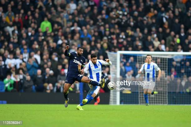 Derby County defender Ashley Cole tackles Brighton forward Alireza Jahanbakhsh during the Emirates FA Cup 5th round tie between Brighton and Hove...