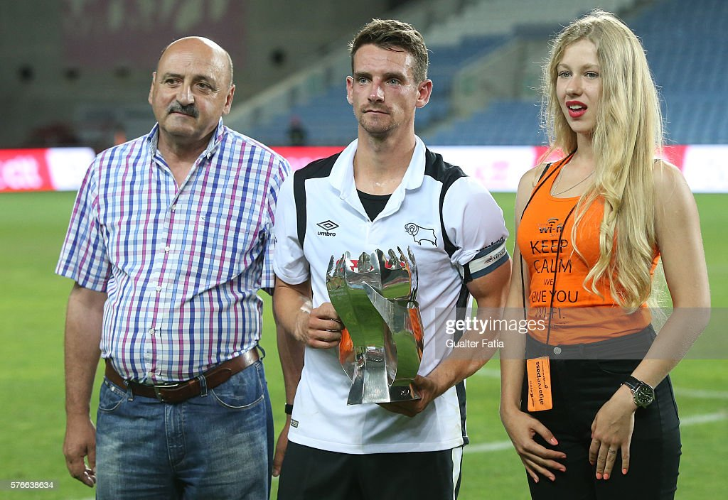 Derby County FC's midfielder Bryson (C) receives the 3rd place trophy at the end of the Algarve Football Cup Pre Season Friendly match between SL Benfica and Derby County at Estadio do Algarve on July 16, 2016 in Faro, Portugal.
