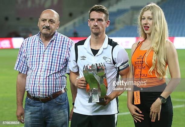 Derby County FC's midfielder Bryson receives the 3rd place trophy at the end of the Algarve Football Cup Pre Season Friendly match between SL Benfica...