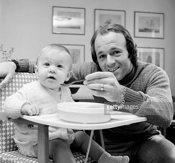 Derby County footballer Archie Gemmill feeding his infant daughter Stacey at home on 4th March 1976