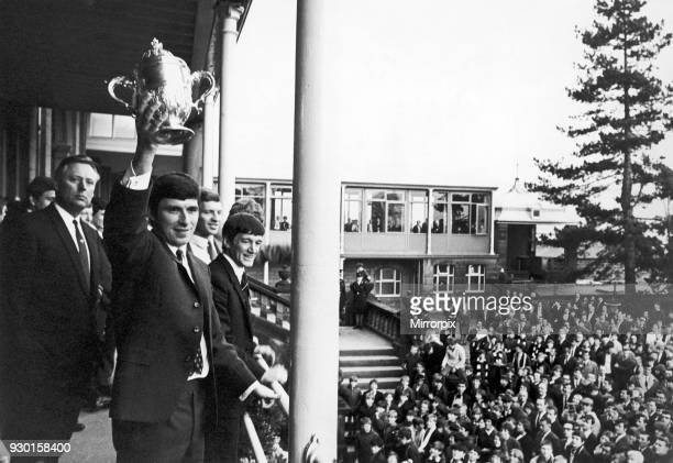 Derby County footballer Kevin Hector proudly holds aloft the Division Two Championship trophy to a jubilant crowds at a civic reception given to them...