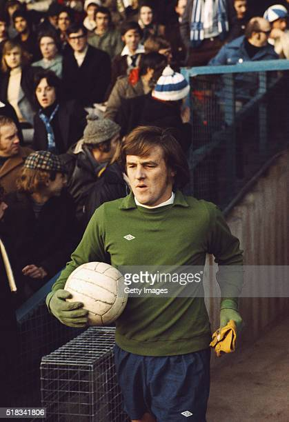 Derby County goalkeeper Colin Boulton complete with gloves and cap, enters the pitch at a match circa 1972.