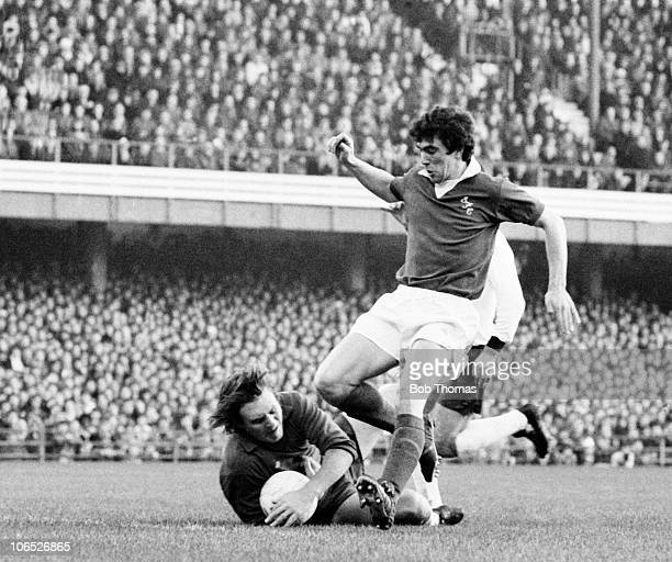 Derby County goalkeeper Colin Boulton saves from Bryan Hamilton of Everton during their Division One match held at The Baseball Ground Derby on 3rd...