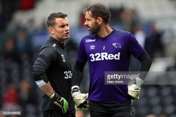 Derby County goalkeeping coach Shay Given alongside goalkeeper Scott Carson during the Sky Bet Championship match between Derby County and Preston...
