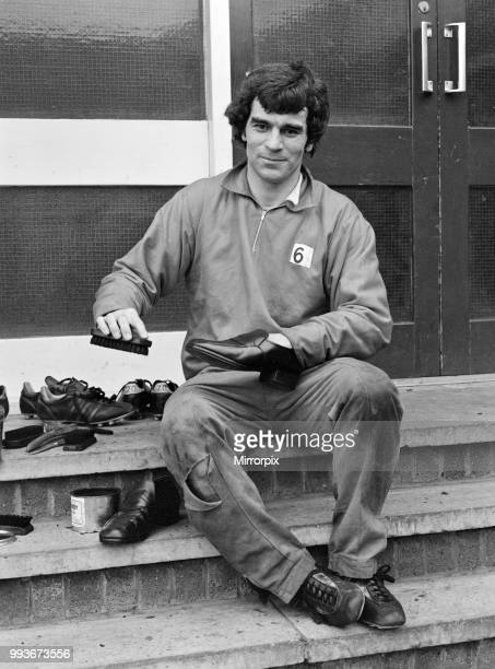 Derby County in training Henry Newton of Derby County FC cleans his shoes during training today his last before Saturday's game 1st April 1976